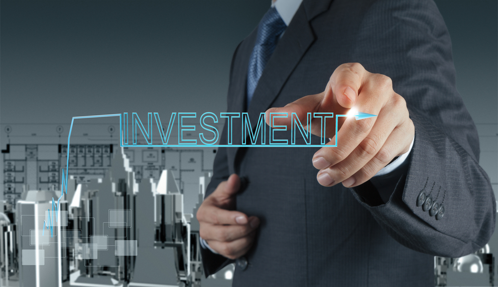 businessman hand pointing to investment concept
