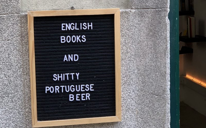 english books shitty portuguese beer sign