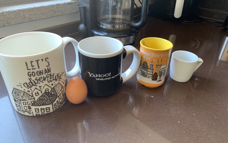 Mug collection with egg for scale